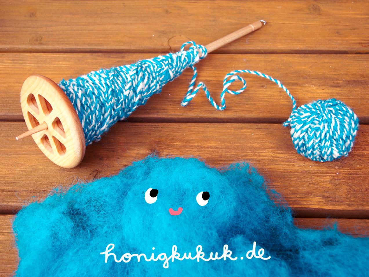 Handspindel und Wolle