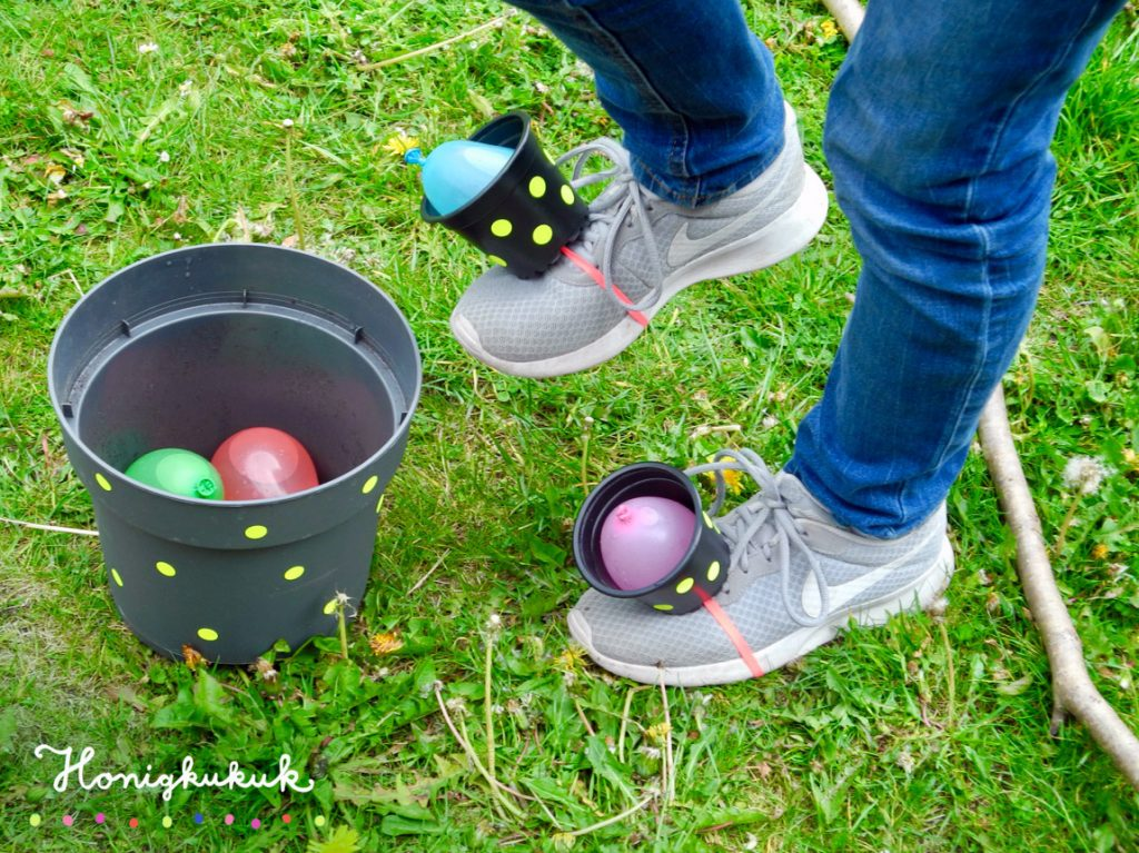 Kindergeburtstagsspiele für die Gartenparty, Upcyclingideen zum Spielen, Wasser-Wettrennen
